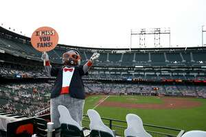 Lou Seal, the San Francisco Giants mascot, waves to the fans outside the ballpark during their game against the San Diego Padres at Oracle Park on July 28, 2020 in San Francisco, California.