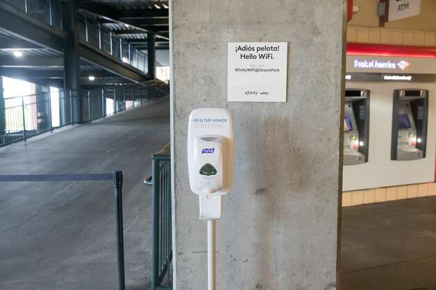 Dispensers of hand sanitizer were placed all over the stadium for workers to use and signs reminded everyone to use them frequently. Photo: Douglas Zimmerman/SFGATE / SFGATE