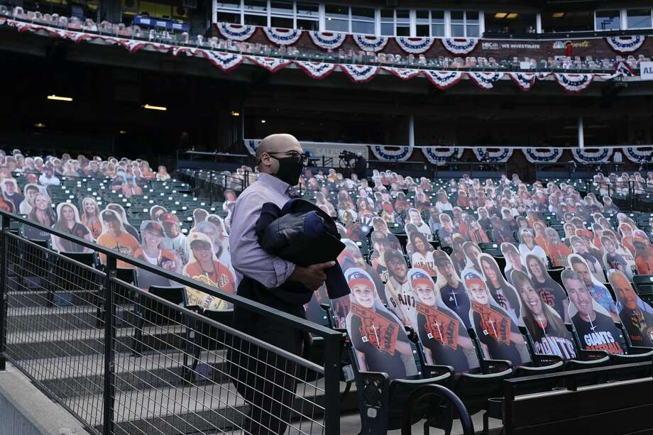 San Francisco Giants president of baseball operations Farhan Zaidi stands in front of cardboard cutouts at Oracle Park before a baseball game between the Giants and the San Diego Padres in San Francisco, Tuesday, July 28, 2020. Photo: Jeff Chiu/Associated Press / Copyright 2020 The Associated Press. All rights reserved