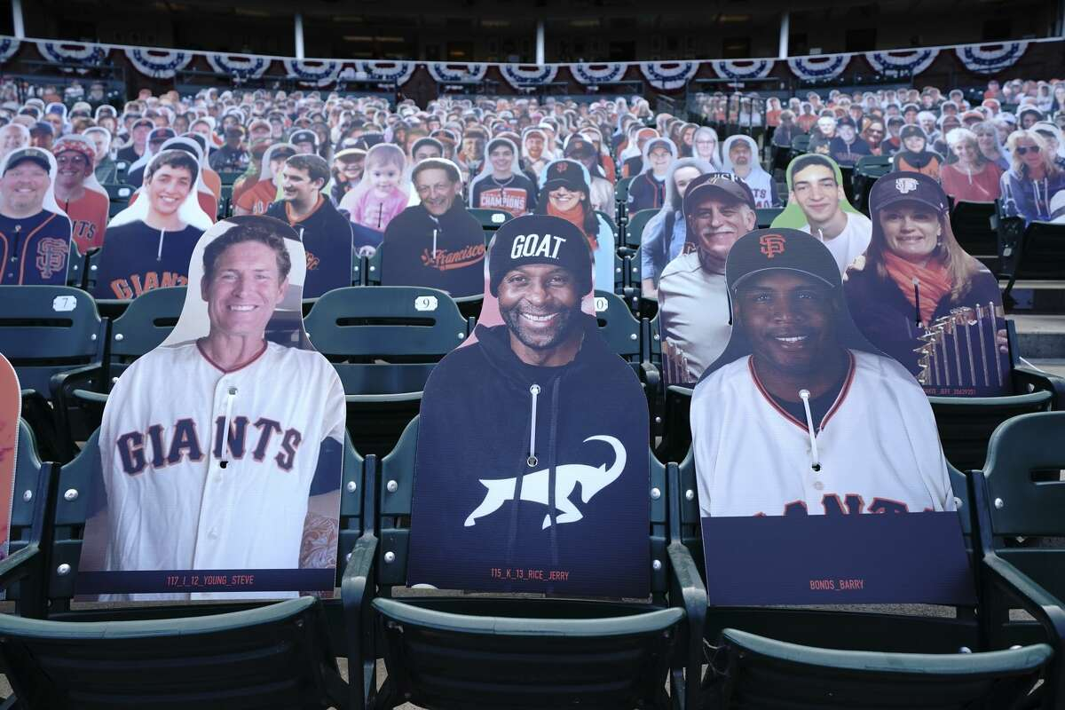 Cardboard cutouts of former football players Steve Young, from left, and Jerry Rice sit next to former baseball player Barry Bonds in seats at Oracle Park before a baseball game between the San Francisco Giants and the San Diego Padres in San Francisco, Tuesday, July 28, 2020.