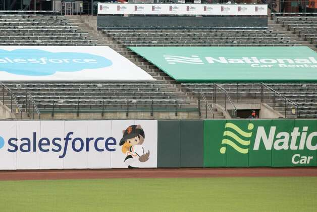 With no backs on the seats, only one San Francisco Giants employee sat in the bleachers behind left field during the game. He didn't even have cardboard cutouts to keep him company. Photo: Douglas Zimmerman/SFGATE / SFGATE