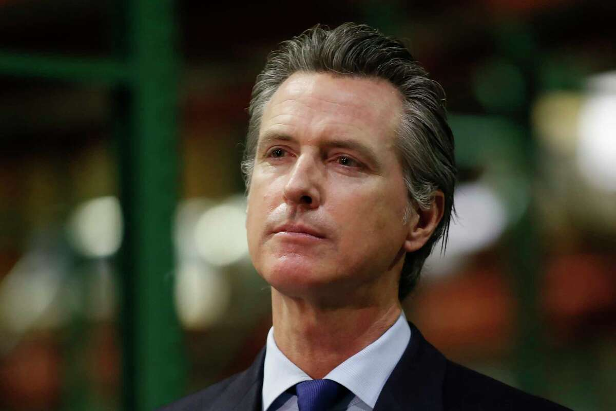 FILE - Gov. Gavin Newsom listens to a reporter's question during a news conference in Rancho Cordova, Calif., Friday, June 26, 2020. Democrats who control California's state Legislature on Monday proposed a $100 billion economic stimulus plan that relies on what they are calling