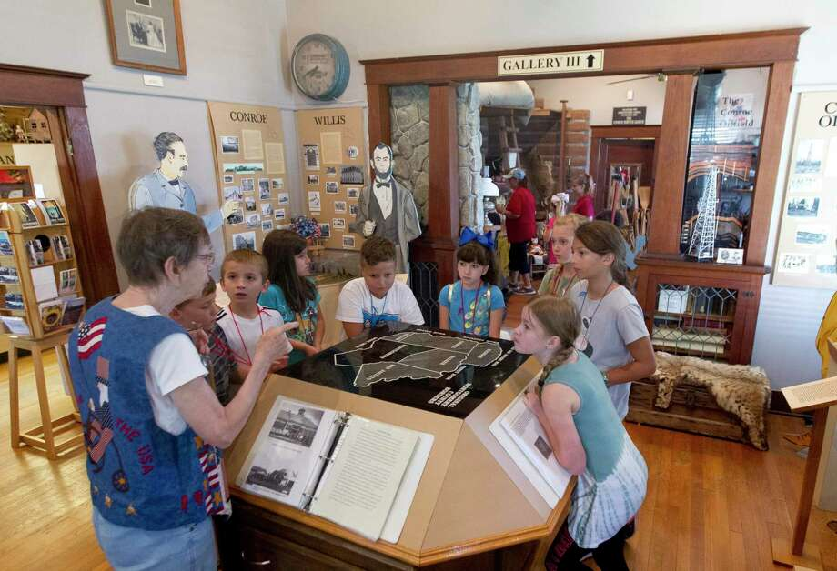 Carolyn Walker, whose family once lived in the 1920s era home, explains how different cities in Montgomery County came to exisit during the annual Pioneer Camp at the Heritage Museum of Montgomery County in 2019. Unfortunately the event had to be postponed this year due to the COVID-19 pandemic. Photo: Jason Fochtman, Houston Chronicle / Staff Photographer / Houston Chronicle