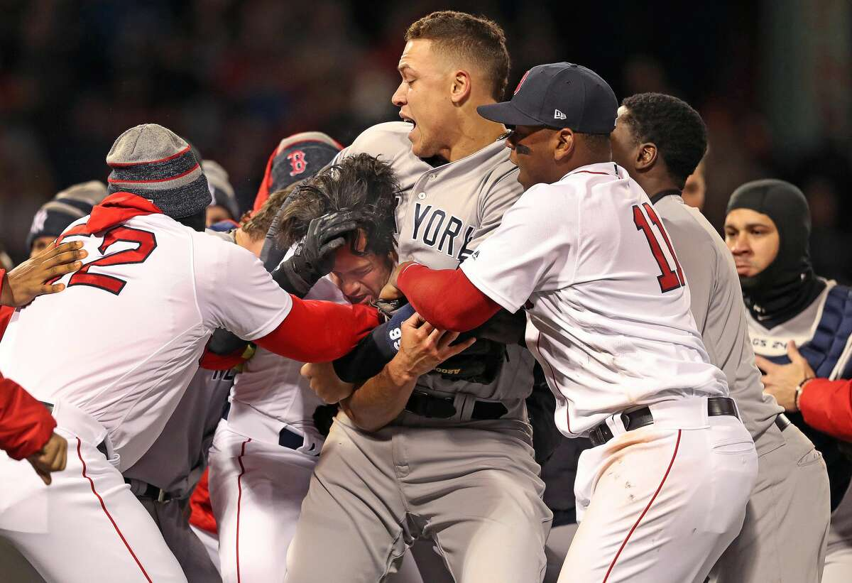 Joe Kelly vs. The Yankees In 2018, Yankees infielder Tyler Austin spiked Boston's Brock Holt on a slide into second base, causing benches to empty but no punches being thrown. When Austin came up to bat, Red Sox reliever Joe Kelly hit him in the ribs with a fastball. That prompted Austin to slam down his bat. Kelly waved him on to charge the mound, which Austin did. Kelly landed some shots on Austin before the Yankees' Aaron Judge put him in a headlock.
