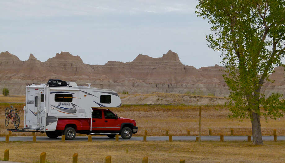 Truck campers are perfect for outdoor recreation and off-grid camping on public lands such as the Badlands National Park in South Dakota. Photo: Motor Matters