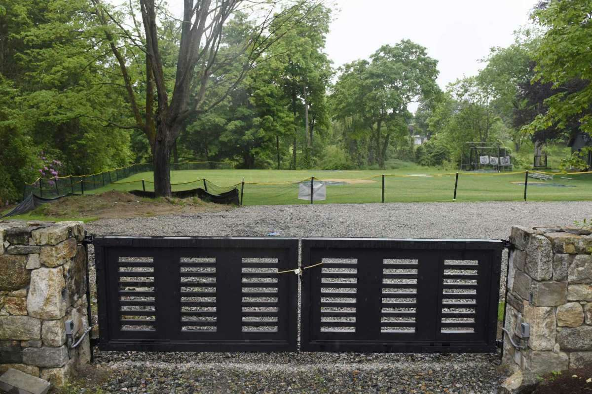 A youth baseball field is on the property of a home on Clapboard Ridge Road in Greenwich, Conn.