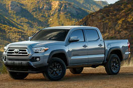 Toyota's 2021 Tacoma Trail Edition is upgraded with dark-gray 16-inch TRD Off-Road wheels and Kevlar-reinforced all-terrain tires, and a grille from the high-end Tacoma Limited.