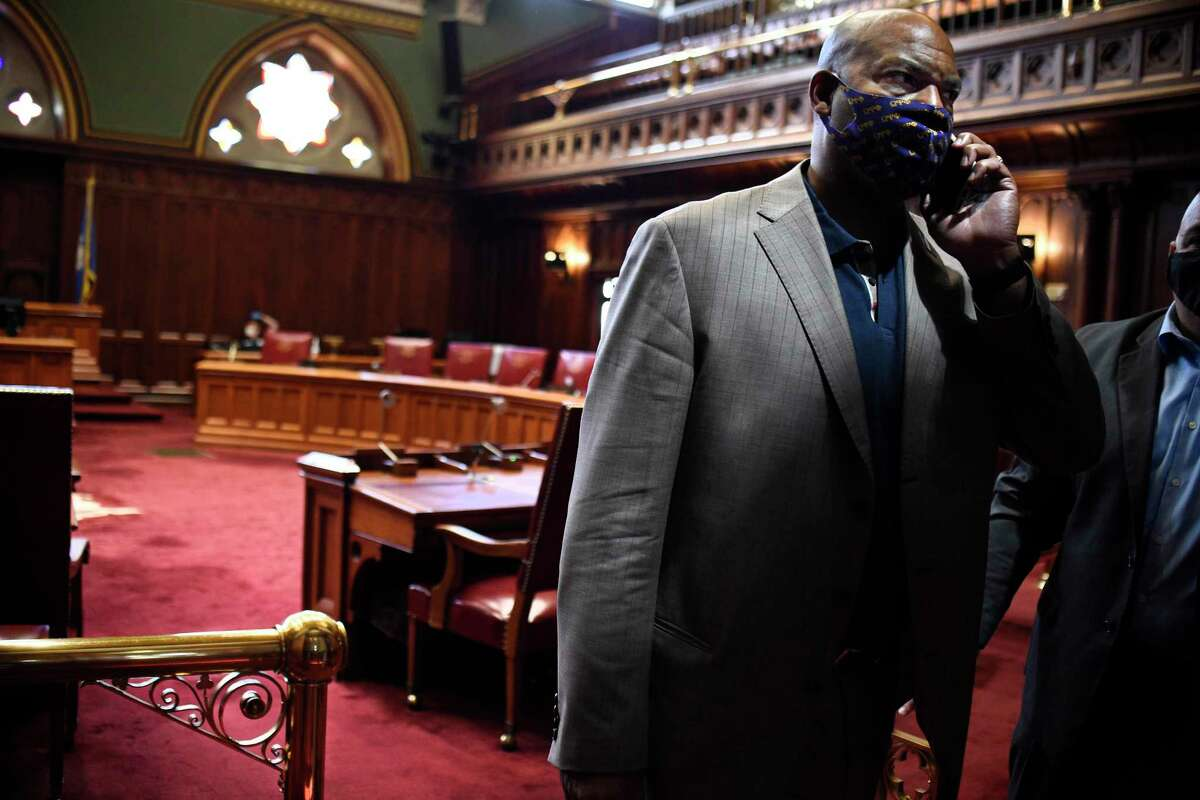 Senator Doug McCrory, D-Hartford, walks off the senate floor after a vote during special session at the State Capitol, Tuesday, July 28, 2020, in Hartford, Conn.