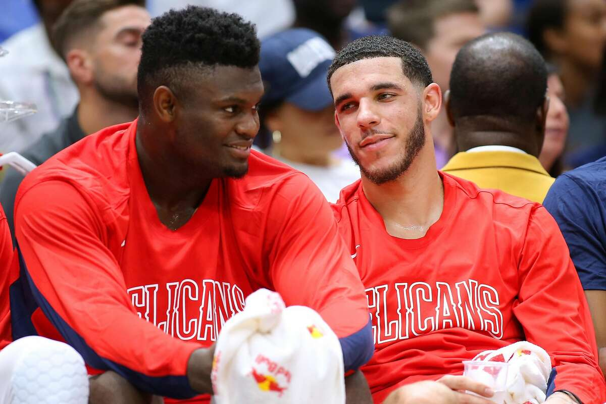 NEW ORLEANS, LOUISIANA - OCTOBER 11: Zion Williamson #1 of the New Orleans Pelicans and Lonzo Ball #2 talk during the second half of a game against the Utah Jazz at the Smoothie King Center on October 11, 2019 in New Orleans, Louisiana. ~~