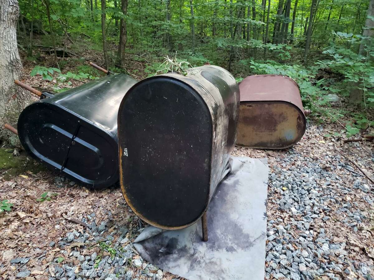 Aquarion Law Enforcement is seeking the public's help in identifying those responsible for dumping these empty oil tanks along Sawmill City Road on Tuesday, July 28.
