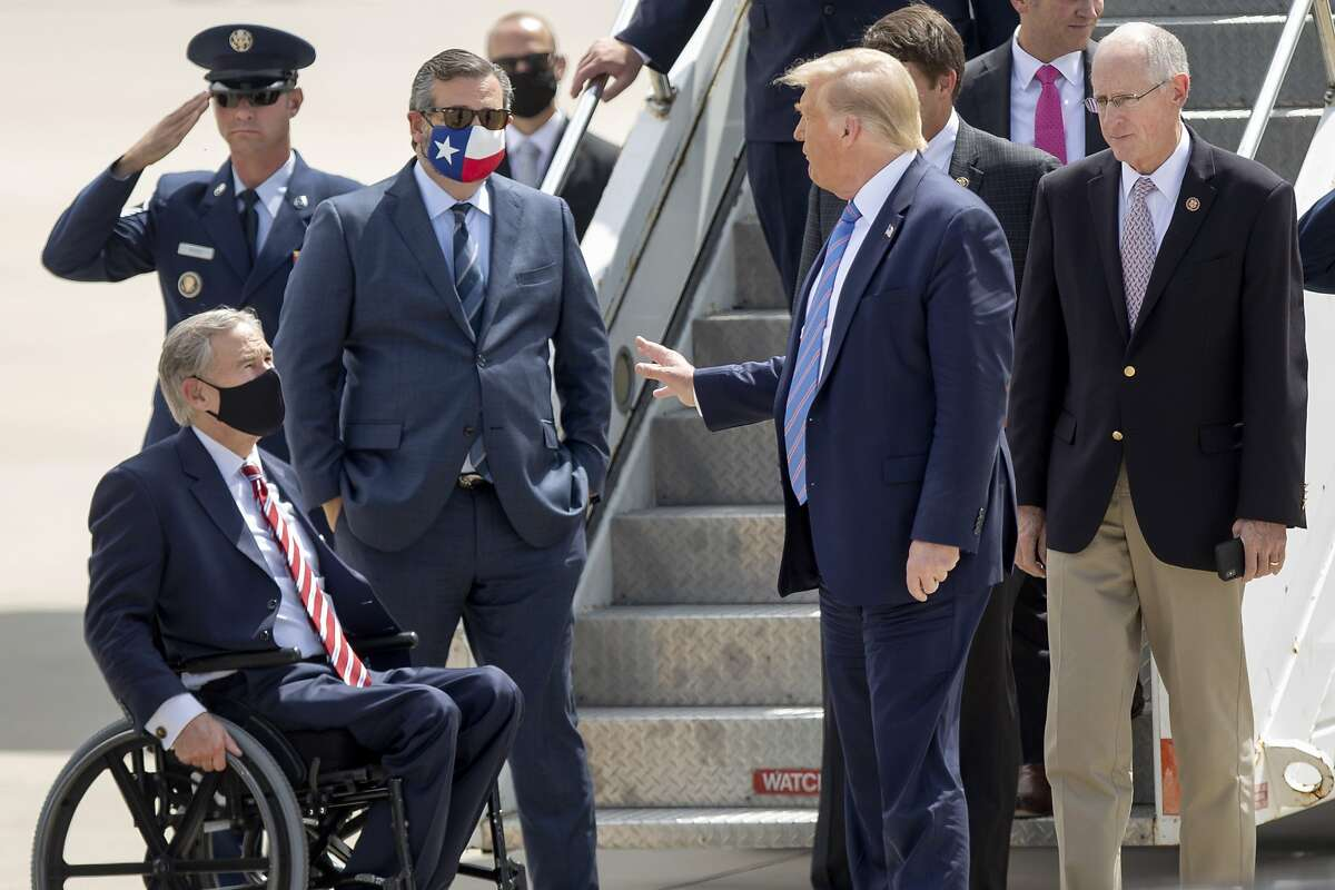 Chatting with Texas Governor Greg Abbott, left, President Donald Trump stands with Representative Mike Conaway, right, after their arrival in Midland Texas Wednesday, July 29, 2020. (Ben Powell/Odessa American via AP)
