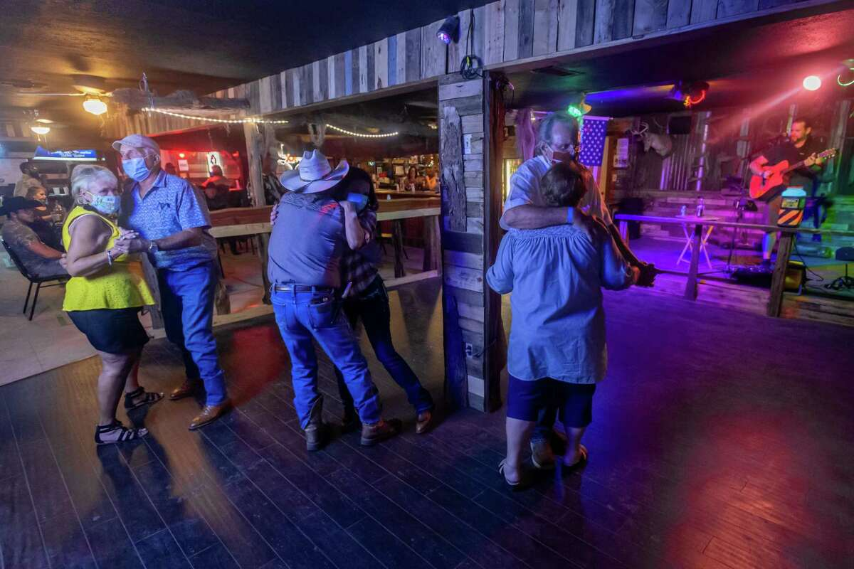 Couples take advantage of the dance floor at Soggy Bottom Saloon while Tim Burge provides the music.The bar in Beaumont joined more than 800 bars in the Freedom Fest State-Wide Unified 51%er Protest defying Governor Greg Abbot??s executive order which shutdown bars. Photo made on July 25, 2020. Fran Ruchalski/The Enterprise