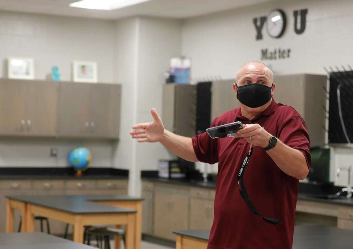 Principal Bryan Gorka talks about spacing of students while touring a science classroom at new Donald J. Stockton Junior High School, Wednesday, July 29, 2020, in Conroe.