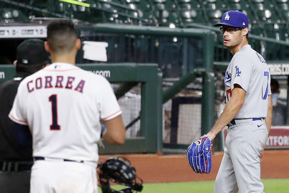 Dodgers reliever Joe Kelly (right) was suspended eight games by MLB on Wednesday after throwing behind Alex Bregman's head and then in on Carlos Correa during Tuesday's game against the Astros. Photo: Karen Warren/Staff Photographer / © 2020 Houston Chronicle
