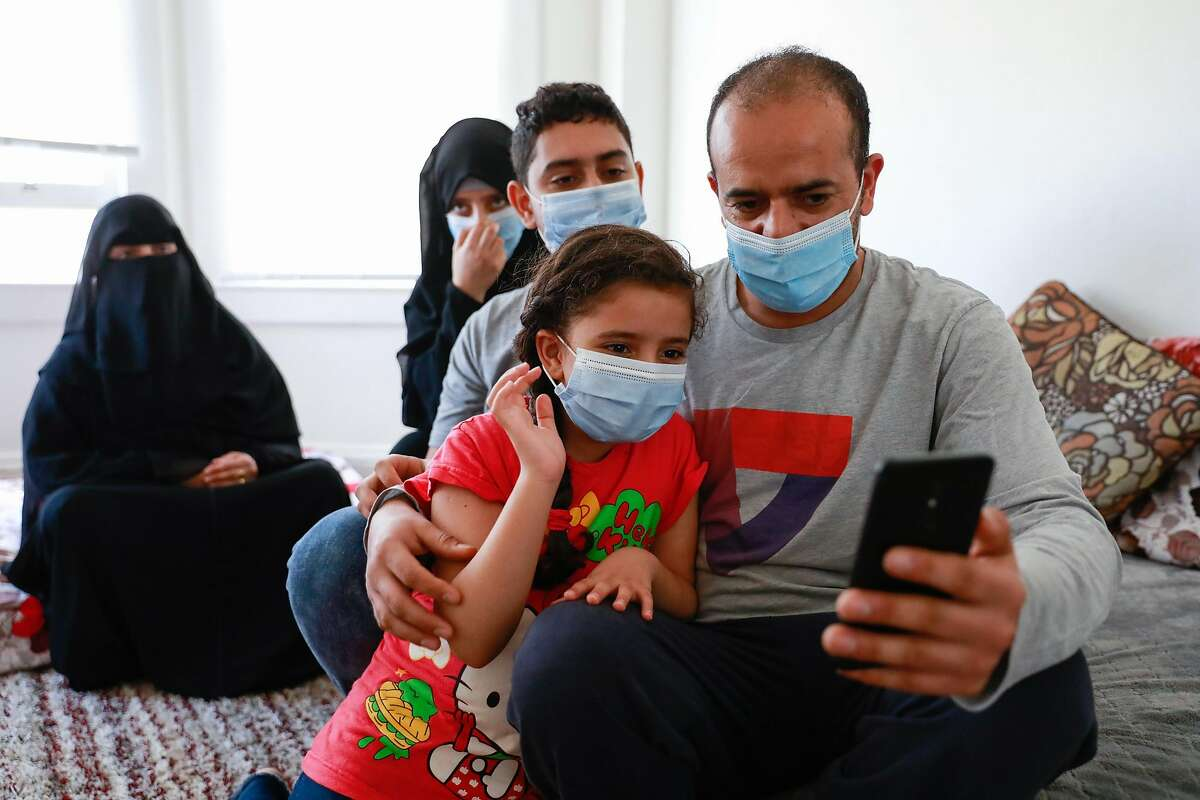 (L-r) Sumaya Bedanai, Asma Saleh, 12, Ahmed Saleh, 14, Maya Saleh , 8, Abu Bakr Saleh talk to sister and daughter Raghad Saleh,10, (not pictured) over video chat on Wednesday, July 22, 2020 in San Francisco, California. Abu Bakr Saleh�s 10-year-old Yemeni daughter, Raghad Saleh, is stranded in Egypt without her family after the Trump administration refused to give her a visa, despite granting one to her parents and three siblings. The family, who waited years for the visas, settled in the Bay Area earlier this month.