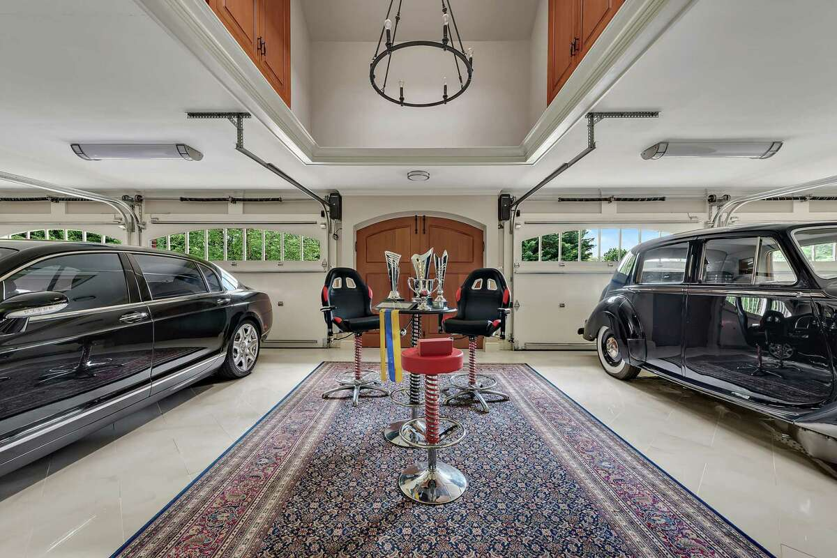 The impressive detached four-car garage is augmented by the carriage house (not pictured), which can accommodate another five vehicles.
