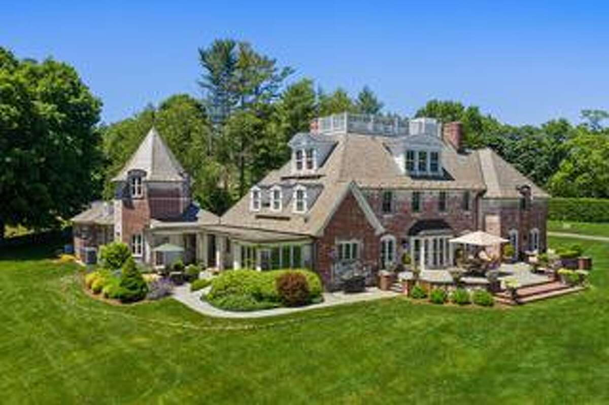 The white-washed red brick French Normandy Chateau-style house at 1135 Mine Hill Road is like something out of the French countryside and the pages of a fairytale. Perhaps the next owners should celebrate settling into their new chateau with a glass of Château Margaux poolside or on the bluestone patio with red brick sitting wall, or from the widow's walk perched atop the slate roof looking upon the professionally landscaped estate with gardens of perennials, specimen trees, and manicured shrubbery.