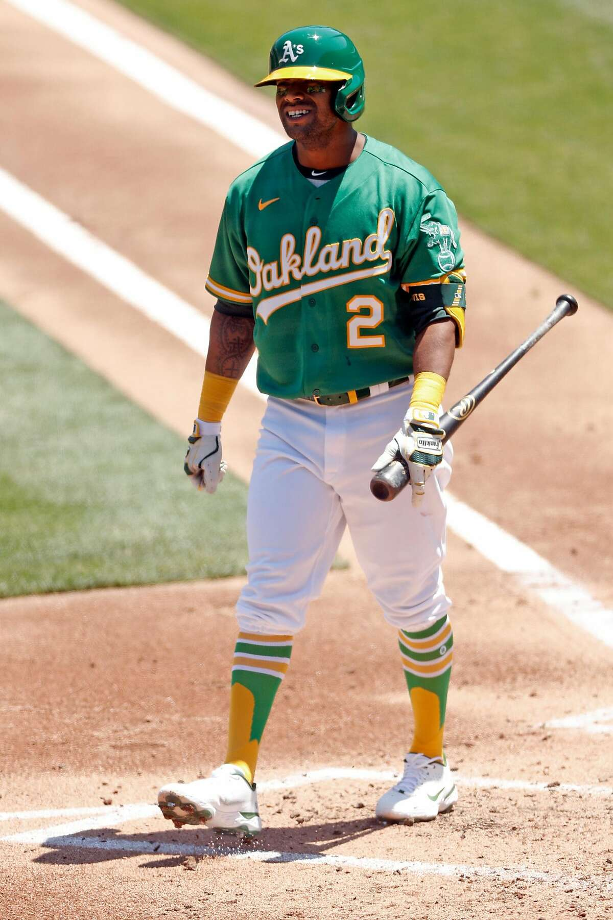 Oakland Athletics' Khris Davis reacts to lining out in 2nd inning against Los Angeles Angels in MLB game at Oakland Coliseum in Oakland, Calif., on Monday, July 27, 2020.