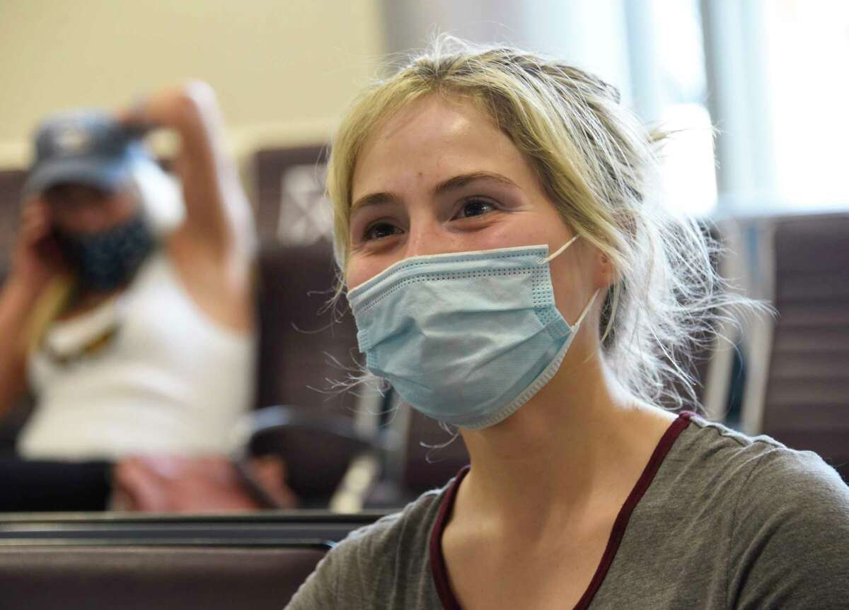 Scarlett DeWitt of Glens Falls waits at her gate before her flight to Orlando at Albany International Airport on Wednesday, July 29, 2020 in Colonie, N.Y. DeWitt will be competing in a beauty contest in Orlando. Florida is one of the 34 quarantine states mandated by Gov. Andrew Cuomo. (Lori Van Buren/Times Union)