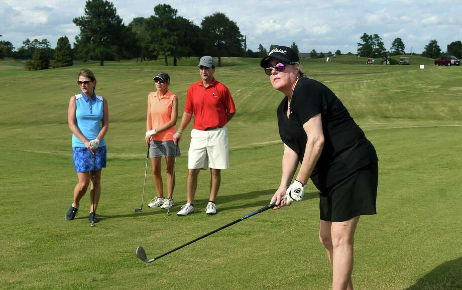 Terri Salesman, from right, of Champions, with playng partners David and Laura Hittler, of Magnolia, and Sheila Boillier, of Houston, follows her tee shot on Loch Course #1 during the Wayne Gloyer Memorial Golf Tournament at Gleannloch Pines Golf Club in Champions on Nov.5, 2018. Photo: Jerry Baker, Houston Chronicle / Contributor / Houston Chronicle