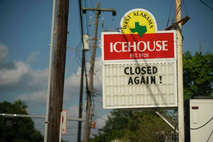 """A sign signals that the West Alabama Ice House is """"Closed Again!"""" , Thursday, July 9, 2020, in Houston. A sign on the door to the ice house that has been in business since 1928 reads """"Closed by the Governor."""""""
