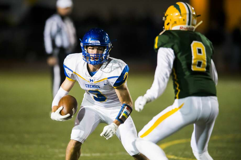Midland High's Tommy Johnstone looks for room to run during an Oct. 25, 2019 game against Dow High. Photo: Daily News File Photo