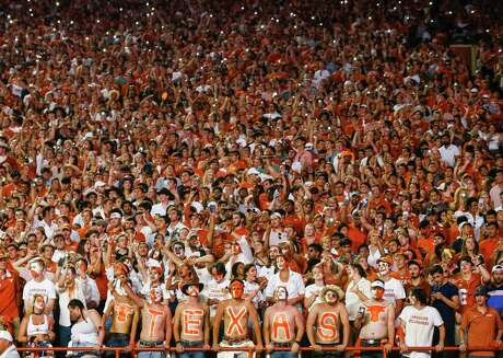 The Texas student section reacts during the fourth quarter of a college football game between the University of Texas and Louisiana State University on Saturday, Sept. 7, 2019 at Darrell Royal Memorial Stadium in Austin, Texas. (Ryan Michalesko/Dallas Morning News/TNS)