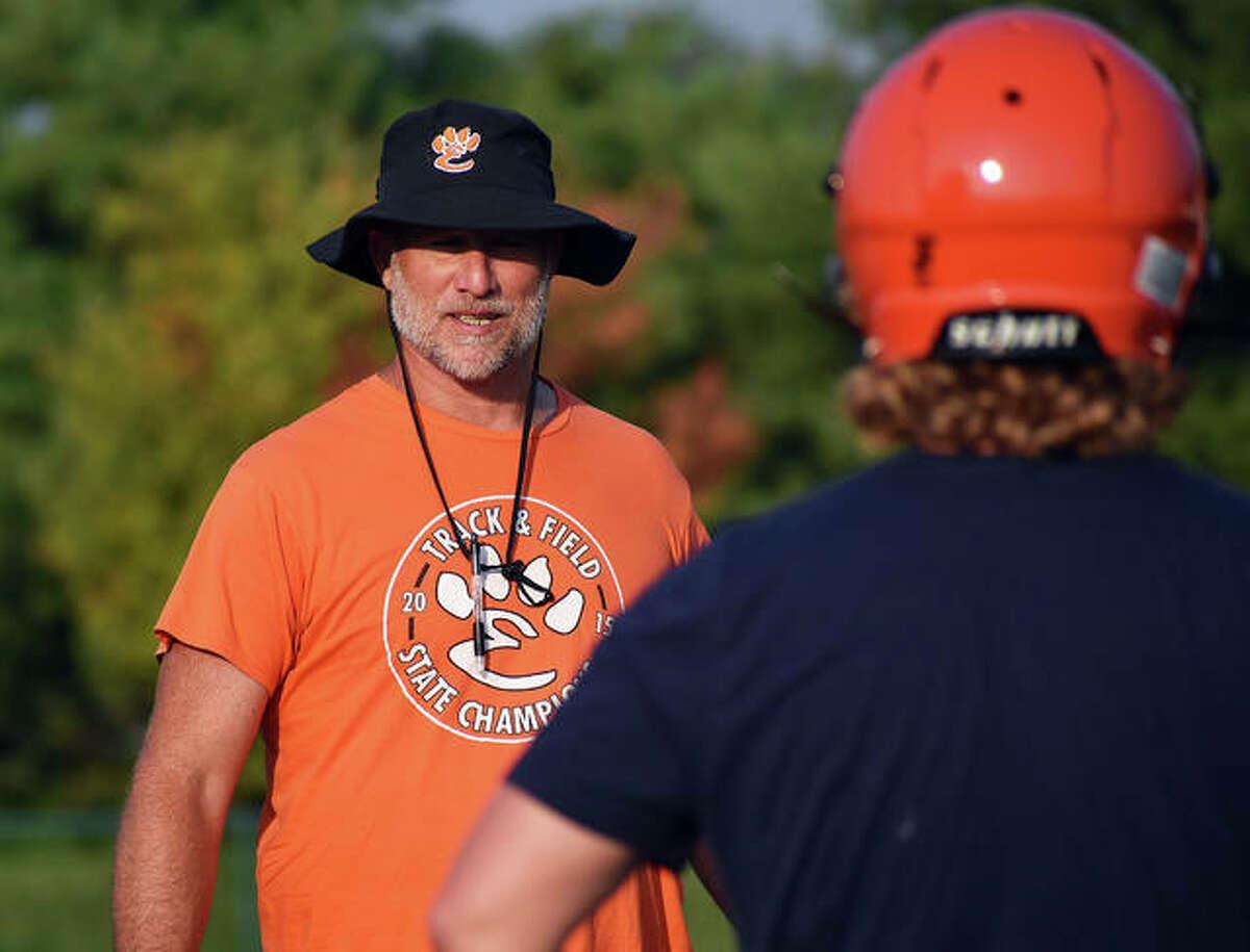 Edwardsville football coach Matt Martin talks to his team earlier this summer inside the District 7 Sports Complex.