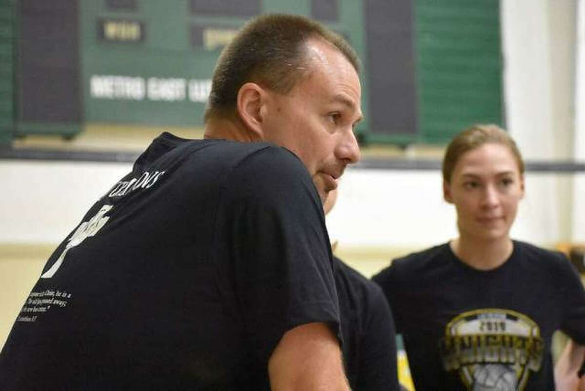 Metro-East Lutheran girls volleyball coach Jon Giordano talks to his team during a practice last summer.