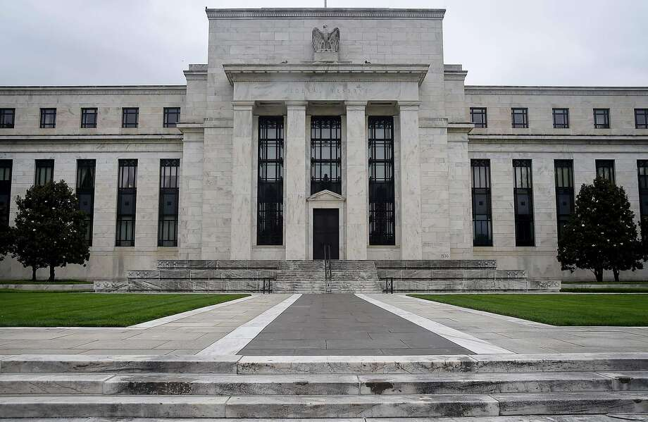(FILES) In this file photo The Federal Reserve building is seen on June 17, 2020 in Washington, DC. - Facing the second recession in just over a decade and with Congress locked in debate over a new emergency spending package, the Federal Reserve on July 29, 2020 will seek a way to put some guardrails on the US economy. The central bank policy committee opened the second day of a two-day meeting Wednesday, with the COVID-19 case count resurging and the death toll approaching 150,000 as economists project a shocking 35 percent collapse of American GDP in the April-June quarter. (Photo by Olivier DOULIERY / AFP) (Photo by OLIVIER DOULIERY/AFP via Getty Images) Photo: Olivier Douliery, AFP Via Getty Images