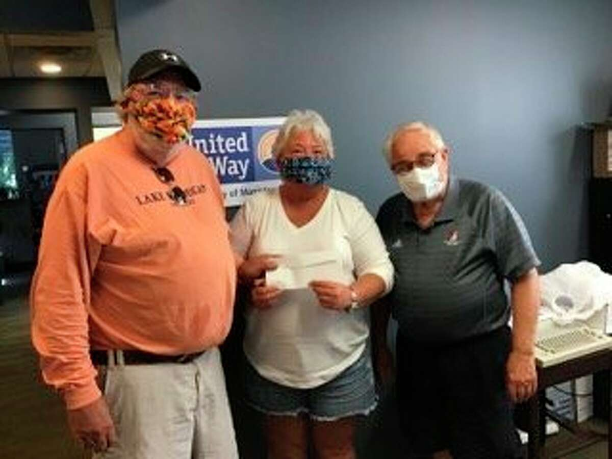 The Manistee County United Way established a new housing and emergency assistance fund thanks to assistance from the 100 Men Who Care of Manistee County. Al Frye (left) present a check toLisa Roberts-Spencer and United Way of Manistee County executive director Corey Van Fleet. (Courtesy Photo/Dick Albee)