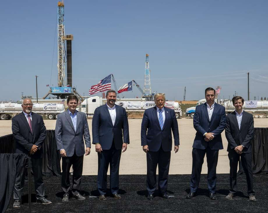 From left: Bob Lange vice president of drilling, Garrett Martin engineering and planning, Cody Campbell co-CEO and co-founder, President Donald Trump, John Sellers co-CEO and co-founder and Blake Carpenter chief operating officer tour a Double Eagle Energy oil and gas operation with a Latshaw Rig No. 43 on Wednesday, July 29, 2020 in Midland County. Jacy Lewis/Reporter-Telegram Photo: Jacy Lewis/Reporter-Telegram / MRT