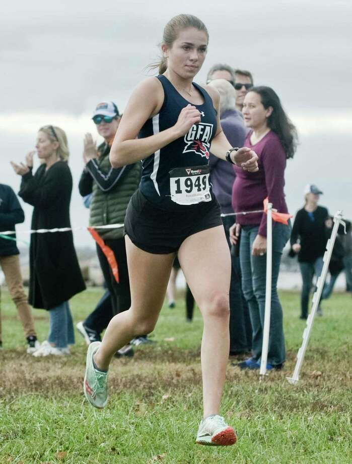 Caroline McCall, of Greens Farms Academy, finishing third in the FAA Girls Cross Country Championships at Sherwood Island in Westport. Monday, Oct. 28, 2019 Photo: Scott Mullin / For Hearst Connecticut Media / The News-Times Freelance