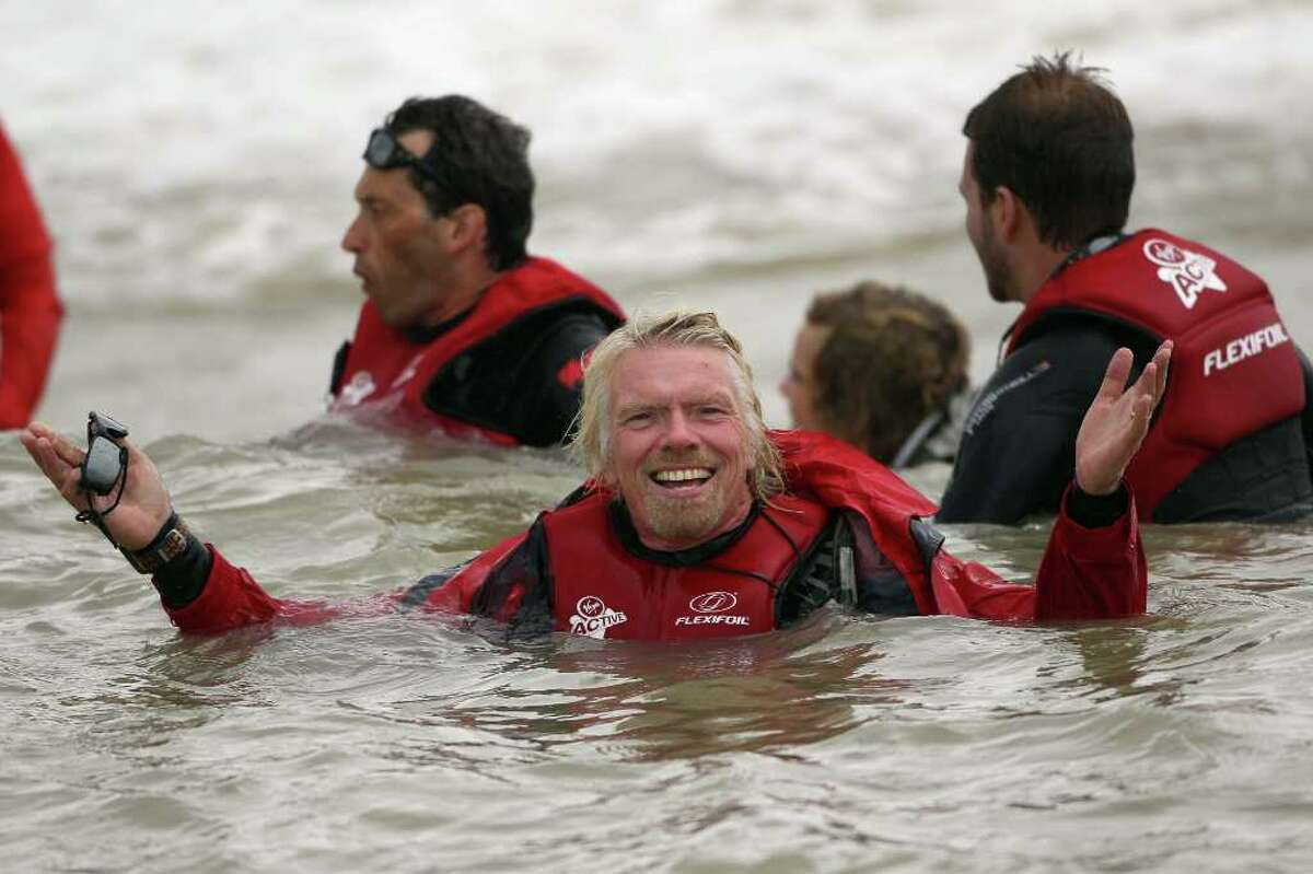 DUNGENESS, UNITED KINGDOM - AUGUST 25: Richard Branson floats in the sea after failing in his attempt to Kite Surf across the English Channel on August 25, 2010 in Dungeness, England. Due to weather conditions, Mr Branson had to call off the attempt, which was to celebrate his 60th birthday, and have him become the oldest person to Kite-surf across the English Channel. (Photo by Dan Kitwood/Getty Images) *** Local Caption *** Richard Branson