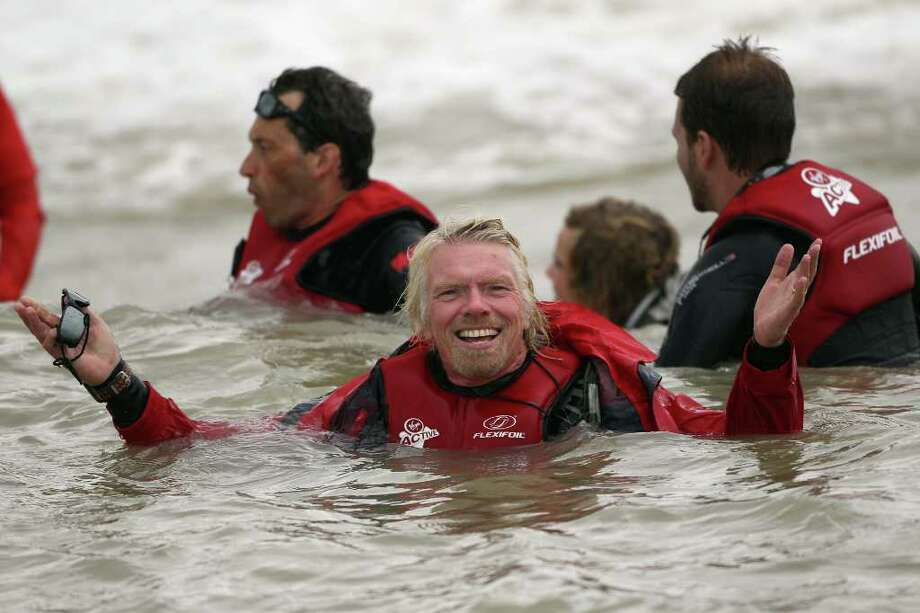 DUNGENESS, UNITED KINGDOM - AUGUST 25:  Richard Branson floats in the sea after failing in his attempt to Kite Surf across the English Channel on August 25, 2010 in Dungeness, England. Due to weather conditions, Mr Branson had to call off the attempt, which was to celebrate his 60th birthday, and have him become the oldest person to Kite-surf across the English Channel.  (Photo by Dan Kitwood/Getty Images) *** Local Caption *** Richard Branson Photo: Dan Kitwood, Getty Images / 2010 Getty Images