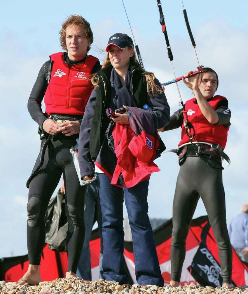 DUNGENESS, ENGLAND - AUGUST 24: Princess Beatrice and boyfriend Dave Clark watch as Richard Branson prepares to Kite Surf across the English Channel on August 24, 2010 in Dungeness, England. Richard Branson is making the attempt to become the oldest person to Kite-surf across the English Channel to celebrate his 60th birthday. (Photo by Dan Kitwood/Getty Images) *** Local Caption *** Dave Clark;Princess Beatrice