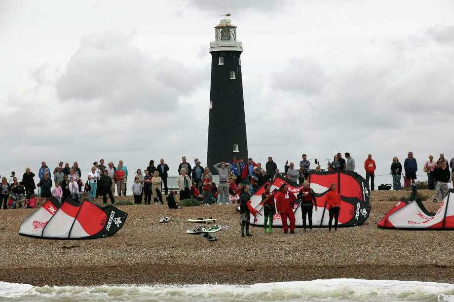 DUNGENESS, UNITED KINGDOM - AUGUST 25:  Richard Branson (2nd-R) stands on the beach after failing in his attempt to Kite Surf across the English Channel on August 25, 2010 in Dungeness, England. Due to weather conditions, Mr Branson had to call off the attempt, which was to celebrate his 60th birthday, and have him become the oldest person to Kite-surf across the English Channel.  (Photo by Dan Kitwood/Getty Images) *** Local Caption *** Richard Branson Photo: Dan Kitwood, Getty Images / 2010 Getty Images