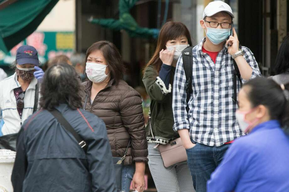 Pedestrians wear masks to protect themselves from the COVID-19 coronavirus in San Francisco's Chinatown neighborhood in San Francisco, Calif. on July 28, 2020. Photo: Douglas Zimmerman/SFGATE / SFGATE
