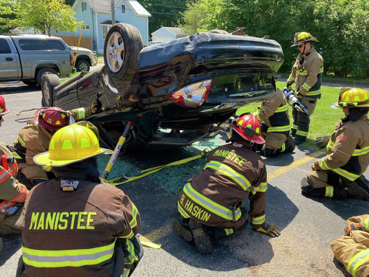 Firefighters performed an annual extrication training at the Manistee City Fire Department on Wednesday. The responders had a chance to work on several different vehicles as each vehicle type presents a unique challenge to emergency responders when a person is trapped. (Courtesy photo)