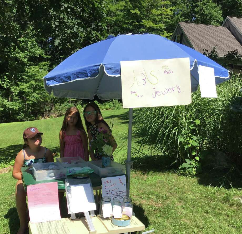 Lydia, Alys and Sonya Hyde of New Milford, above, have teamed up with Agnes, Henry and Vincent Schiesel of New Preston to launch a homemade jewelry business, with proceeds to support organizations in the community. Photo: Courtesy Of The Hydes / Danbury News Times Contributed