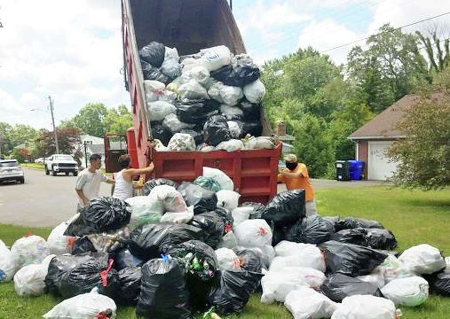 Kiwanis Club of Middletown on July 11 hosted a Stuff a Truck event in coordination with Jeff Myjak, founder of Cans 4 a Cause, to raise money for the Kiwanis Program, Warm the Children. Photo: Contributed Photo