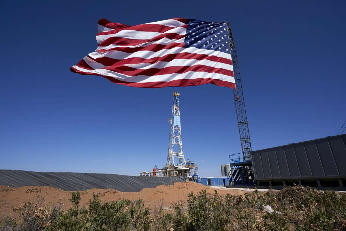 An American flag is displayed at a Double Eagle Energy Holdings LLC oil rig in Midland, Texas, U.S., on Wednesday, July 29, 2020.