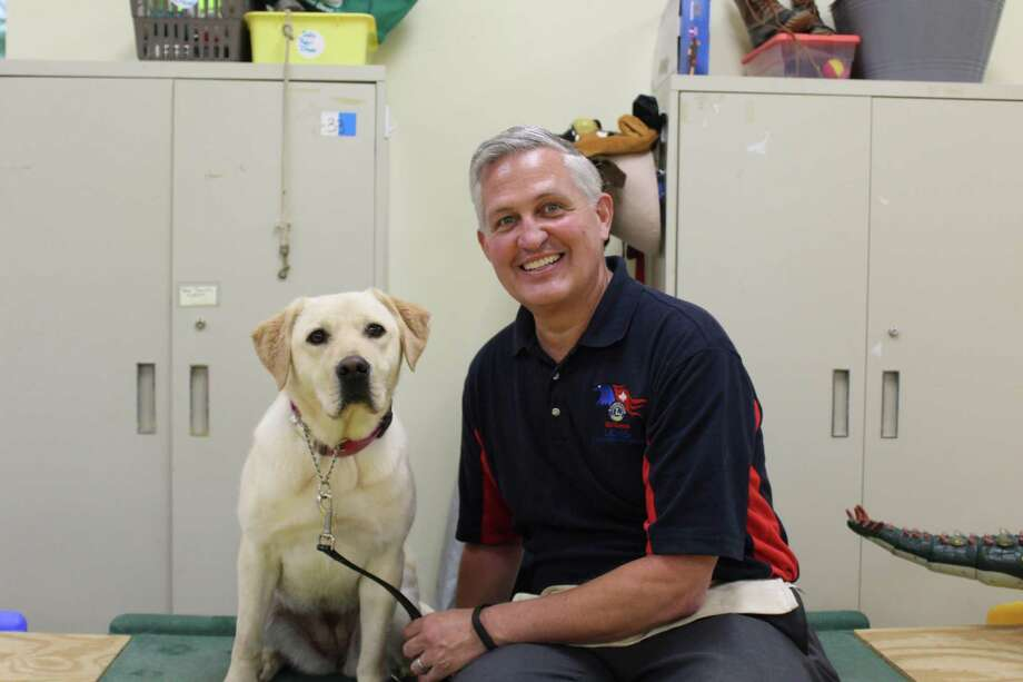 Dave Roberts, of West Granby, cared for an ECAD Service Dog in Training at his home during the COVID-19 stay at home order. He was one of 35 volunteer Home Handlers to step up and help ECAD during the three -month lockdown. Photo: ECAD / Contributed Photo /