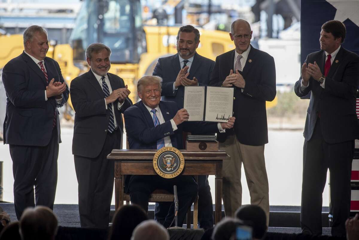President Donald Trump signs four permits ?' for pipeline and railroad infrastructure along the Texas border that will allow for Texas crude to be exported to Mexico ?' at a Double Eagle Energy oil and gas operation with Latshaw Rig No. 43 on Wednesday, July 29, 2020 in Midland County. Jacy Lewis/Reporter-Telegram