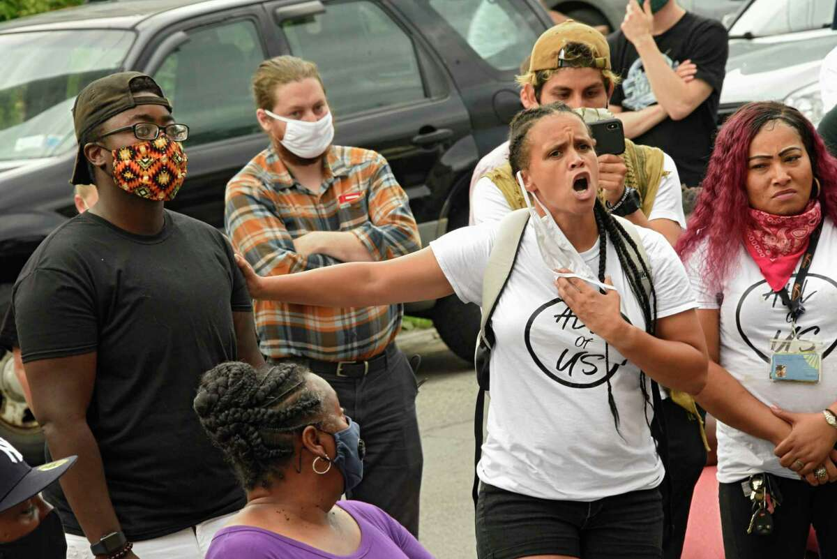 All of Us leader Jamaica Miles pulls her mask down to speak as police and city leaders meet with neighborhood groups and ministers to talk about reforms needed in the police department at the Tabernacle Baptist Church on Wednesday, July 29, 2020 in Schenectady, N.Y. (Lori Van Buren/Times Union)