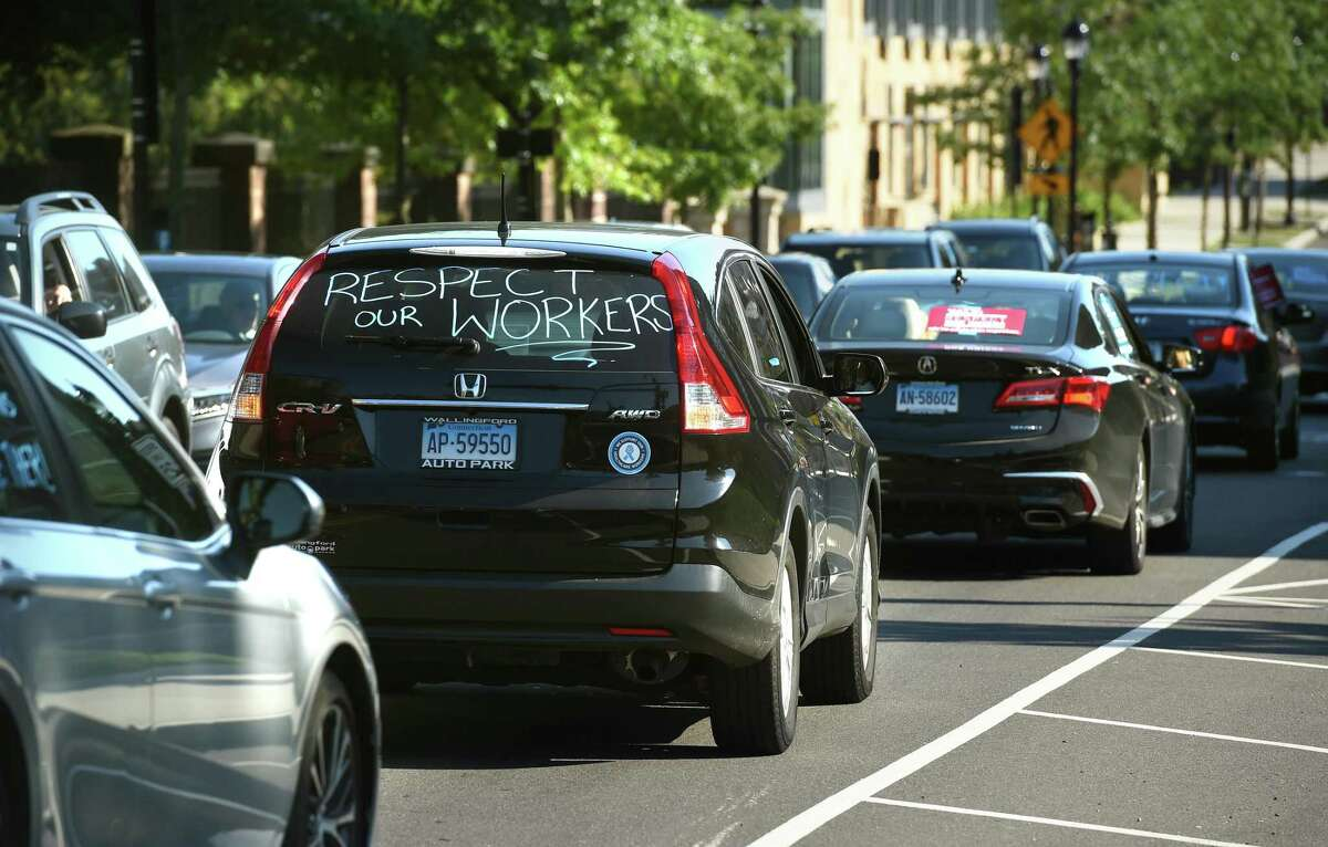 Vehicles travel down Prospect Street in New Haven during a Yale University Union Local 34 and 35 rally on July 29, 2020. Yale spokeswoman Karen Peart issued a statement Wednesday in which she said,