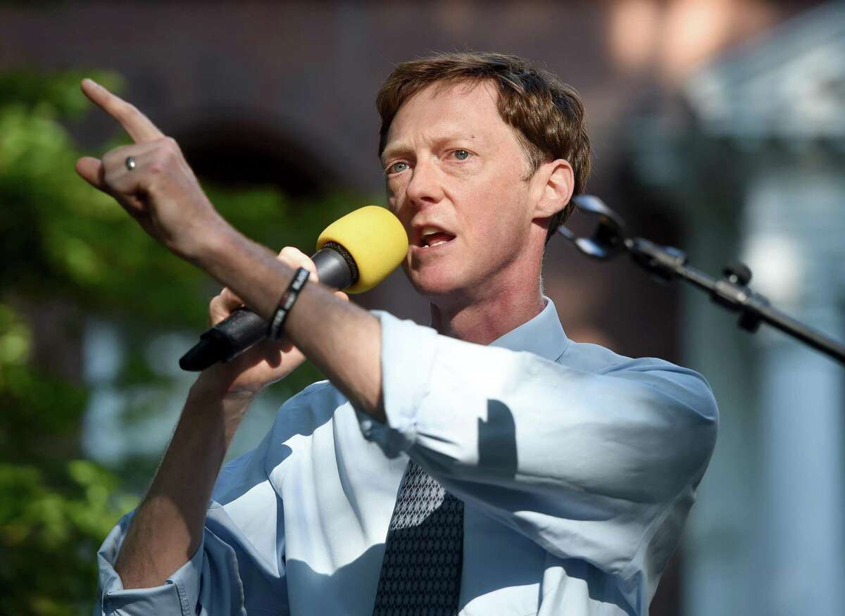 New Haven Mayor Justin Elicker speaks at a Yale University Union Local 34 and 35 rally on Hillhouse Avenue in New Haven on July 29, 2020 in front of the home of Yale University President Peter Salovey. Mayor Justin Elicker said,