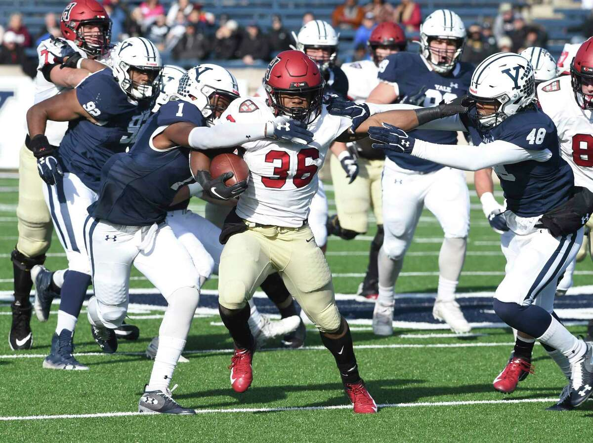 Harvard's Devin Darrington runs against Yale during the first half during a game in New Haven in November.