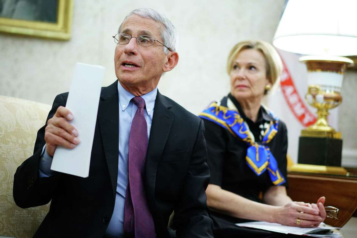 (FILES) In this file photo taken on April 29, 2020, Dr. Anthony Fauci (L), director of the National Institute of Allergy and Infectious Diseases speaks next to Response coordinator for White House Coronavirus Task Force Deborah Birx, during a meeting with US President Donald Trump in the Oval Office of the White House in Washington, DC. (Photo by MANDEL NGAN / AFP) (Photo by MANDEL NGAN/AFP via Getty Images)