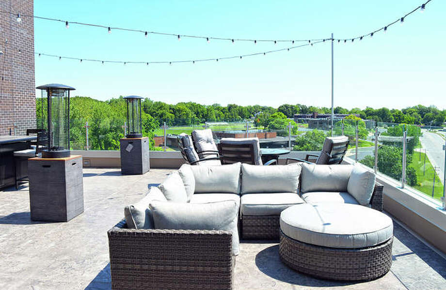 Just like the South Tower, the North Tower also has rooftop patios, complete with fire pits, conversation nooks and other features while taking in the view. Photo: Courtesy Of Fireside Financial